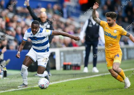 Bright Osayi-Samuel of QPR keeps the ball in play as Sean Maguire of Preston North End  appeals