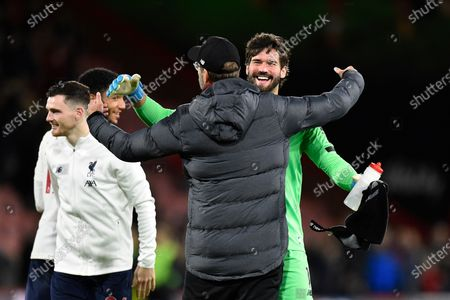 Liverpool manager Jurgen Klopp celebrates the 3-0 win with Alisson Becker (1) of Liverpool at full time during the Premier League match between Bournemouth and Liverpool at the Vitality Stadium, Bournemouth