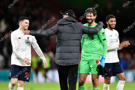Liverpool manager Jurgen Klopp celebrates the 3-0 win with Andrew Robertson (26) of Liverpool and Alisson Becker (1) of Liverpool at full time during the Premier League match between Bournemouth and Liverpool at the Vitality Stadium, Bournemouth