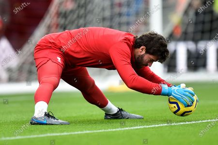 Alisson Becker (1) of Liverpool showing off his flexability during the warm up ahead of the Premier League match between Bournemouth and Liverpool at the Vitality Stadium, Bournemouth