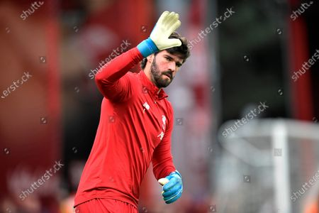 Alisson Becker (1) of Liverpool waves during the warm up ahead of the Premier League match between Bournemouth and Liverpool at the Vitality Stadium, Bournemouth