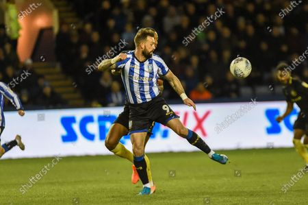 Steven Fletcher of Sheffield Wednesday takes the ball down after a long cross during the EFL Sky Bet Championship match between Sheffield Wednesday and Brentford at Hillsborough, Sheffield