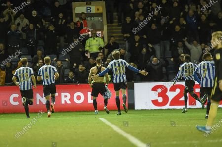 The Sheffield Wednesday players join Steven Fletcher of Sheffield Wednesday in celebrating their teams second goal and taking the lead during the EFL Sky Bet Championship match between Sheffield Wednesday and Brentford at Hillsborough, Sheffield