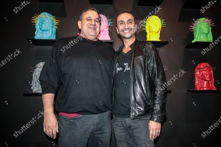 Stock Image of Guido Lombardi and artist Howtan Re during official opening of the exhibition Save Me! at the Howtan Space in Rome, Italy 06-12-2019