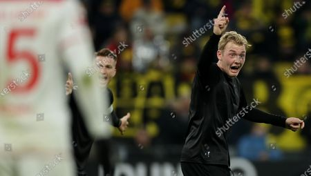 Dortmund's Marco Reus and Dortmund's Julian Brandt (R) react during the German Bundesliga soccer match between Borussia Dortmund and Fortuna Duesseldorf in Dortmund, Germany, 07 November 2019.