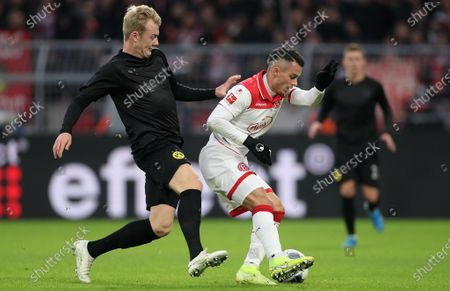 Dortmund's Julian Brandt (L) in action against Duesseldorf's Erik Thommy (R) during the German Bundesliga soccer match between Borussia Dortmund and Fortuna Duesseldorf in Dortmund, Germany, 07 November 2019.
