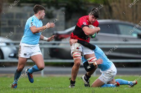 Garryowen vs UCC. UCC's Richard Thompson tackled by Garryowen's Liam Coombes