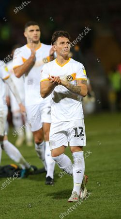 Danny McNamara of Newport County applauds the Newport fans at the end of the match