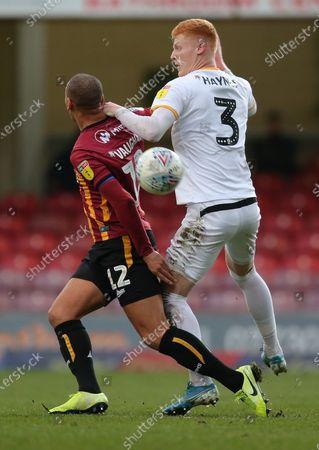 Ryan Haynes of Newport County and James Vaughan of Bradford City