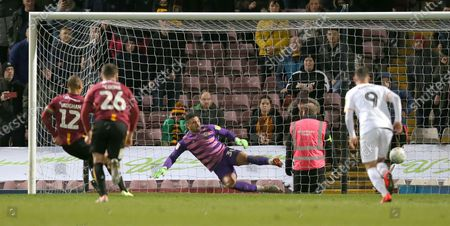 Nick Townsend of Newport County cannot stop the penalty from James Vaughan of Bradford City