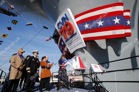 Caroline Kennedy, daughter of former President John F. Kennedy., smashes a bottle on the bow of the ship as she christens of the nuclear aircraft carrier John F. Kennedy at Newport News Shipbuilding in Newport News, Va