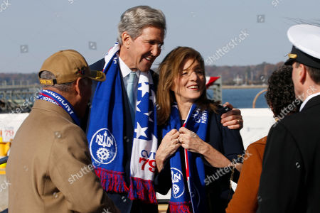 Caroline Kennedy, John Kerry. Caroline Kennedy, daughter of former President John F. Kennedy, right, gets a hug from former Secretary of State, John Kerry, left, after she smashed a bottle on the bow of the nuclear aircraft carrier John F. Kennedy at Newport News Shipbuilding in Newport News, Va