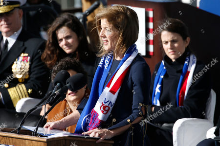 Caroline Kennedy, daughter of former President John F. Kennedy, speaks to the crowd as she prepares to christen the nuclear aircraft carrier John F. Kennedy at Newport News Shipbuilding in Newport News, Va