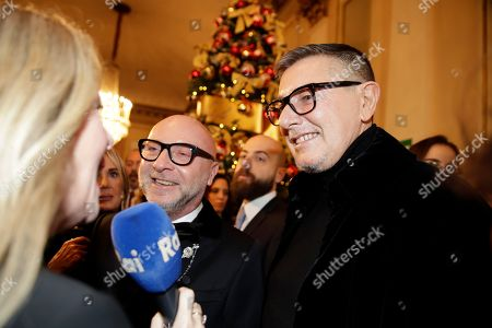 "Italian designer Domenico Dolce, left, and Stefano Gabbana arrive for the gala premiere of La Scala opera house, in Milan, Italy,. Milan's storied La Scala opens its 2019-2020 season on Saturday with Puccini's ""Tosca,"" which stars Russian soprano Anna Netrebko as the object of unwanted sexual attention from a powerful authority figure"