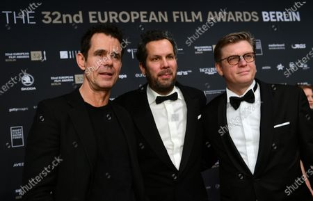 Stock Picture of Tom Tykwer and cast members of the German TV series 'Babylon Berlin' director Achim von Borries and director Henk Handloegten pose on the the red carpet of the 32nd European Film Awards ceremony in Berlin, Germany, 07 December 2019.