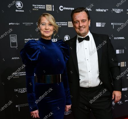 Stock Image of Members of cast of the film 'Queen of Hearts', director Niclas Bendixen (R) and actress Trine Dyrholm (L), pose on the red carpet of the 32nd European Film Awards ceremony in Berlin, Germany, 07 December 2019.