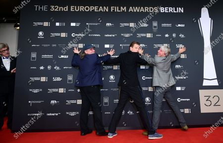 Wim Wenders (L), the President of the European Film Awards, watches members of the cast of the film 'Gundermann' including actor Alexander Scheer (2-R) and director Andreas Dresen (R) joking for the media on the red carpet of the 32nd European Film Awards ceremony in Berlin, Germany, 07 December 2019.