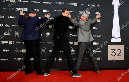 Stock Photo of Members of the cast of the film 'Gundermann' including actor Alexander Scheer (2-R) and director Andreas Dresen (R) joke for the media on the red carpet of the 32nd European Film Awards ceremony in Berlin, Germany, 07 December 2019.