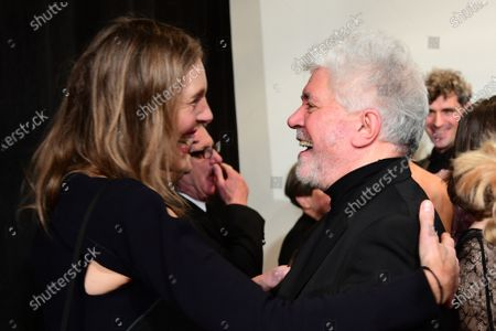 Stock Photo of Donata Wenders (L), wife of German director Wim Wenders, and Spanish director Pedro Almodovar (R) hug during their arrival for the 32nd European Film Awards ceremony in Berlin, Germany, 07 December 2019.