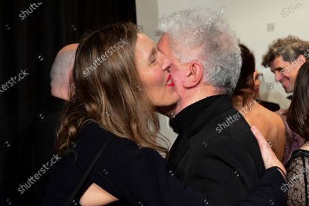 Donata Wenders (L), wife of German director Wim Wenders, and Spanish director Pedro Almodovar (R) hug during their arrival for the 32nd European Film Awards ceremony in Berlin, Germany, 07 December 2019.