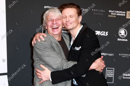 Stock Picture of Members of the cast of the film 'Gundermann', German actor Alexander Scheer (R) and German director Andreas Dresen (L) attend the red carpet of the 32nd European Film Awards ceremony in Berlin, Germany, 07 December 2019.