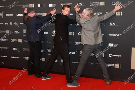 Members of the cast of the film 'Gundermann', including actor Alexander Scheer (2-R) and director Andreas Dresen (R) joke for the media on the red carpet of the 32nd European Film Awards ceremony in Berlin, Germany, 07 December 2019.