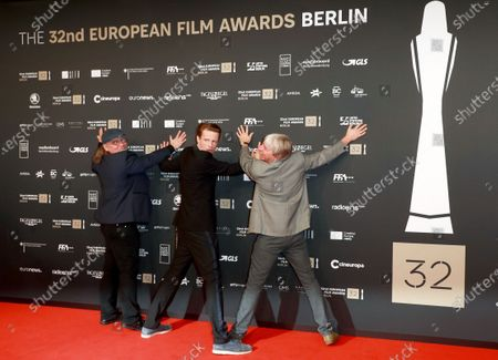 Stock Image of Members of the cast of the film 'Gundermann', including actor Alexander Scheer (2-R) and director Andreas Dresen (R) joke for the media on the red carpet of the 32nd European Film Awards ceremony in Berlin, Germany, 07 December 2019.