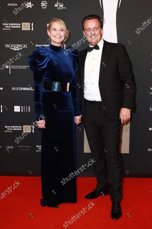 Stock Photo of Members of cast of the film 'Queen of Hearts', Danish director Niclas Bendixen (L) and Danish actress Trine Dyrholm (R) attend the red carpet of the 32nd European Film Awards ceremony in Berlin, Germany, 07 December 2019.