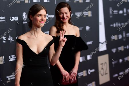 Members of the cast of the German TV series 'Babylon Berlin', actress Liv Lisa Fries (L) and Hannah Herzsprung, pose on the red carpet of the 32nd European Film Awards ceremony in Berlin, Germany, 07 December 2019.