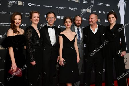 Stock Image of Members of the cast of the German TV series 'Babylon Berlin' actress Hannah Herzsprung, actress Leonie Benesch, actor Volker Bruch, actress Liv Lisa Fries, actor Ivan Shvedoff, actor Benno Fuermann and actress Fritzi Haberlandt pose on the red carpet of the 32nd European Film Awards ceremony in Berlin, Germany, 07 December 2019.