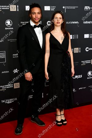 Stock Picture of Corentin Fila (L) and Belgian actress Daphne Patakia (R) attend the red carpet of the 32nd European Film Awards ceremony in Berlin, Germany, 07 December 2019.