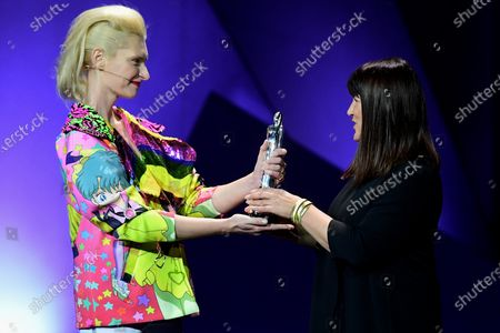 Stock Photo of Croatian producer Ankica Juric Tilic (R) receives the Eurimages Co-Production Award from Polish actress Agata Buzek (L) during the 32nd European Film Awards ceremony in Berlin, Germany, 07 December 2019.