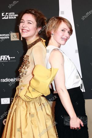 Stock Photo of Aiste Dirziute (L) and German actress Anna Brueggemann (R) attend the red carpet of the 32nd European Film Awards ceremony in Berlin, Germany, 07 December 2019.