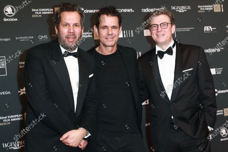Stock Image of Cast members of the German TV series 'Babylon Berlin' director Achim von Borries and German director Tom Tykwer and director Henk Handloegten attend the red carpet of the 32nd European Film Awards ceremony in Berlin, Germany, 07 December 2019.
