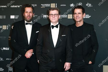 Cast members of the German TV series 'Babylon Berlin' director Achim von Borries and director Henk Handloegten and German director Tom Tykwer attend the red carpet of the 32nd European Film Awards ceremony in Berlin, Germany, 07 December 2019.