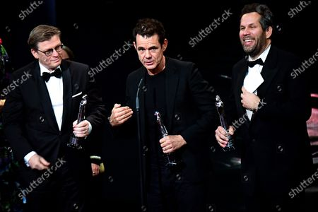 German directors Achim von Borries (R), Henk Handloegten (L) and Tom Tykwer (R) receive their European Achievement in Fiction Awards during the 32nd European Film Awards ceremony in Berlin, Germany, 07 December 2019.