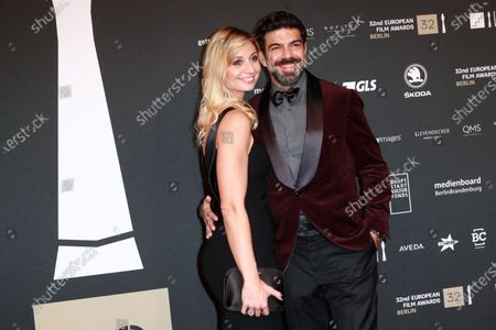 Stock Photo of Member of the cast of the film 'The Traitor' Italian actor Pierfrancesco Favino (L) and his wife Anna Ferzetti (R) attend the red carpet of the 32nd European Film Awards ceremony in Berlin, Germany, 07 December 2019.