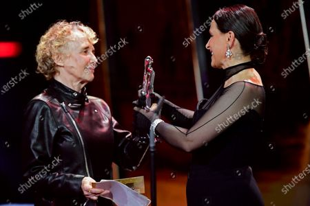 Juliette Binoche (R) reacts as she is awarded the European Achievement in World prize from French film director Claire Denis (L) during the 32nd European Film Awards ceremony in Berlin, Germany, 07 December 2019.
