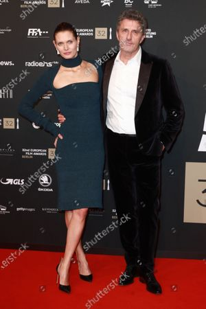 Stock Photo of Pawel Pawlikowski (R) and his wife polish actress and model Malgorzata Bela (L) attend the red carpet of the 32nd European Film Awards ceremony in Berlin, Germany, 07 December 2019.