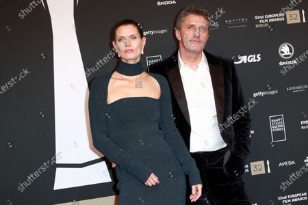 Stock Image of Pawel Pawlikowski (R) and his wife polish actress and model Malgorzata Bela (L) attend the red carpet of the 32nd European Film Awards ceremony in Berlin, Germany, 07 December 2019.