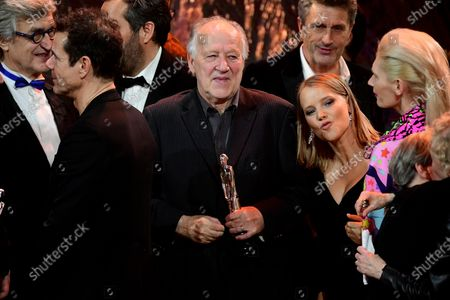Werner Herzog (C) is seen with his EFA Lifetime Achievement Award during the 32nd European Film Awards ceremony in Berlin, Germany, 07 December 2019.