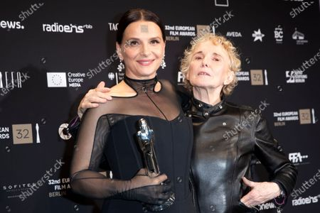 Juliette Binoche (L), winner of the award European Achievement in World award, and French film director Claire Denis (R), pose during the 32nd European Film Awards ceremony in Berlin, Germany, 07 December 2019.