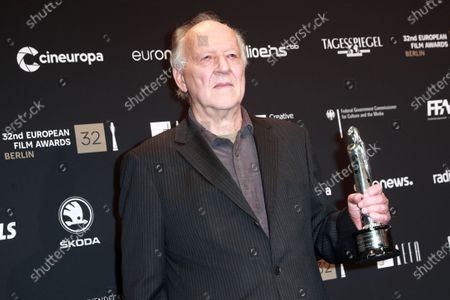 Werner Herzog poses with the EFA Lifetime Achievement Award during a photo-call after the 32nd European Film Awards ceremony in Berlin, Germany, 07 December 2019.