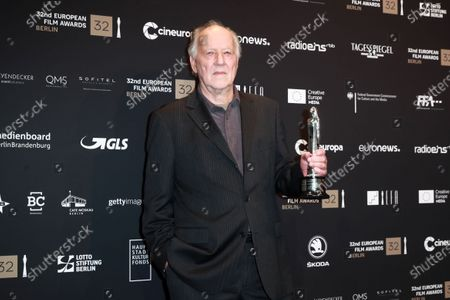 Stock Image of Werner Herzog poses with the EFA Lifetime Achievement Award during a photo-call after the 32nd European Film Awards ceremony in Berlin, Germany, 07 December 2019.