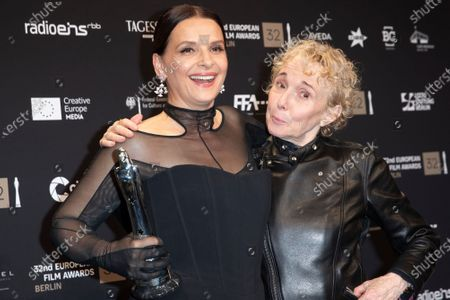 Juliette Binoche (L) poses with trophy next to French film director Claire Denis during a photo-call after the 32nd European Film Awards ceremony in Berlin, Germany, 07 December 2019.
