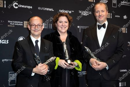 Ed Guiney, Lee Magiday and Andrew Lowe pose with trophies during a photo-call after the 32nd European Film Awards ceremony in Berlin, Germany, 07 December 2019.