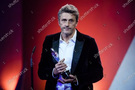 Pawel Pawlikowski receives the EFA People's Choice Award during the 32nd European Film Awards ceremony in Berlin, Germany, 07 December 2019.