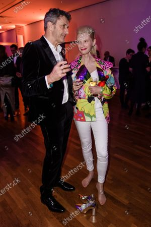 Pawel Pawlikowski (L) and Polish actress Agata Buzek (R) attend the after show party of the 32nd European Film Awards in Berlin, Germany, 07 December 2019.