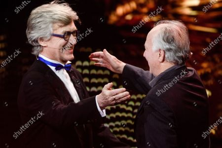 Stock Photo of Wim Wenders (L) congratulates German director Werner Herzog (R) as Herzog receives the EFA Lifetime Achievement Award during the 32nd European Film Awards ceremony in Berlin, Germany, 07 December 2019.