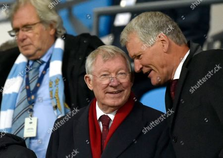 Stock Photo of Former Manchester United manager Sir Alex Ferguson, center, speaks with former Manchester United chief executive David Gill before the English Premier League soccer match between Manchester City and Manchester United at Etihad stadium in Manchester, England